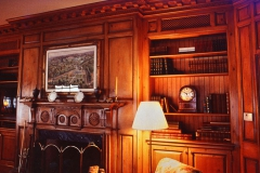 Custom paneled library and fireplace